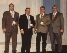 David Kent, second from left, accepts his Senior Partner award at the 2009 Agents Rally. Click to Close